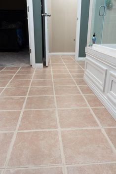 Make your tiled floor look brand new again! This tutorial has the easiest tips and tricks to paint your tile grout with just a few simple steps. Avoid the hassle of cleaning your dirty grout lines and find the best paint products to freshen up your grout. Grout Paint, Sanded Grout, Tile Grout, Grout Repair, Easy Tile, Painting Tile Floors, Throw In The Towel, Diy Porch, Home Upgrades