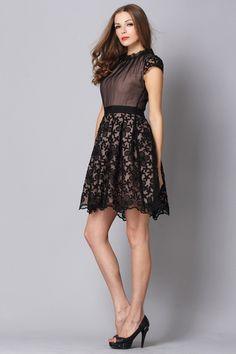 sweetest little black dress. love the embroidered skirt.