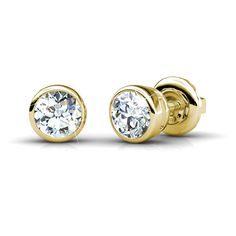 The elegant curves of this pair of diamond stud earrings will add classic beauty to anything. The 14KT yellow gold setting provides the perfect frame for the two round cut diamonds that they encircle, allowing the I-J color and VS2-SI1 clarity of the diamonds to burst forth in all their radiance. A 0.25CT total weight will give sparkle and style to any outfit that cannot be missed. For simple but powerful elegance look no further than this spectacular pair of diamond stud earrings.