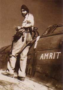 """Flt. Lt. M.S. Pujji and his Hurricane. He wrote """"I was posted to No.253 Squadron RAF, flying Hurricane IIB fighters from RAF Kenley, which is a couple of miles south of Croydon. We were a mixed bunch, with pilots also from Poland, America, Canada and Australia."""""""