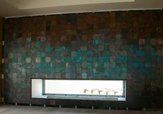 Wall panel covered with VeroMetal Copper, green patina
