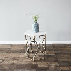 The Nicely side table is one of our absolute favorite editions. It features a hexagonal base in a textured champagne finish and a crisp white marble top. There are only a few of this unique edition available! As always, your editions ship directly to you with free returns- not that you'll need them with finds this gorgeous!