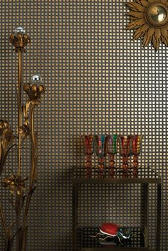 Mosaic Cube Wallpaper A smart wallpaper inspired by the symmetry and mosaics of the Art Deco period,  featuring little cubes printed with accents of metallic gold on a charcoal grey ground.
