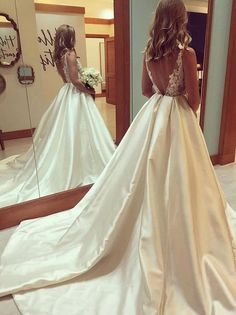 A line long cheap wedding dresses. Plus size backless wedding dresses with lace top.Sexy backless taffeta bridal gowns with court train.