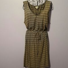 Striped dress Fine black and white stripes give the overall appearance of dark gray. Very comfortable, t-shirt fabric. Elastic gather and tie waist. Falls to just above knee. Merona Dresses Midi
