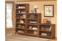 From Ashley Furniture - Tall, medium, and small brown wooden bookcases.  The middle one should be the right size for my office.