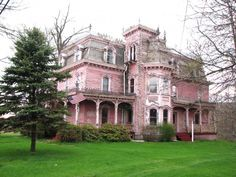 """""""This amazing house is in the town of New Berlin, NY (population 1,129.) The locals pronounce the town name with the accent on the first syllable of Berlin. In spite of its appearance, this house is not abandoned. It is the most elaborate Mansard Style house I have ever seen. The mansard roof is slate, with wrought iron cresting that looks like lace. I would guess that it was built in the early 1870s. ...and it is PINK!!!!"""""""