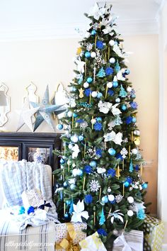 I'll Have a Blue Christmas Tree @A T The Picket Fence. LOVE the pops of blue on this beauty.