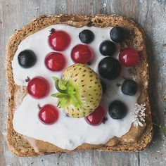 Breakfast idea: toast with nut butter, vanilla coconut cream and berries.