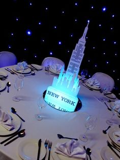 Illuminated New York Table Centre (TBL78) to hire.  The perfect addition to any Hollywood themed event; our exclusive and unique centre piece will certainly add the wow-factor to your American, Hollywood or Movie themed party.