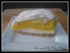 Lemon Lush | Tasty Kitchen: A Happy Recipe Community! It's just like my favorite chocolate desert only with lemon pudding! YUM! (this recipe uses pecan sandies cookies for the crust, can't wait to try it.)