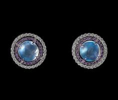Moonstone, amethyst and diamond ear studs - The unique color and shape of the moonstones trimmed with diamonds and amethysts provides a whimsical new approach to classic ear studs.