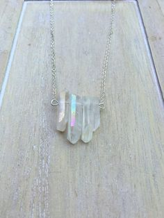Short silver colored Angel Aura Quartz bar necklace