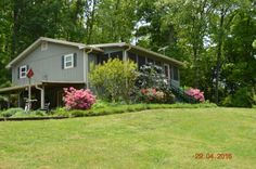 271 County Road 38, Riceville, TN 37370 | MLS #963153 - Zillow.  I am in love with this place!  5 acres, gorgeous flowers, garden, private, two screen porches plus a covered rocking chair area, 4 beds, 2 baths, 2 kitchens, 2400 sq ft.  $169,000