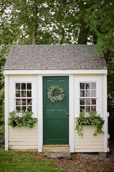 Garden shed with wreath. More easy ways to restyle your garden shed at www.redonline.co.uk