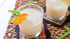 Coconut Creamsicle Margarita With Tequila, Triple Sec, Coconut Water, Coconut Cream, Orange Juice, Honey, Shredded Coconut, Fresh Orange, Fresh Lime