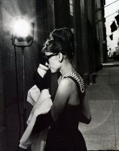 Audrey Hepburn drinking coffee. She even makes that coffee cup look elegant.