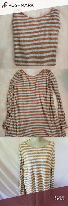 Free People oversized sweater dress Perfect oversize large neck knit sweater dress with Brown and baby-blue stripes. Perfect condition super comfy and perfect with a nice pair of leggings or just by itself Free People Dresses