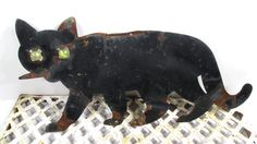 Vintage  Black Metal Marble Eye Cat Rusty by UrbanRenewalDesigns, $25.00