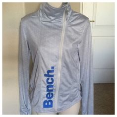 """BENCH geometric athletic workout jacket Nordstrom This is an amazing athletic jacket from the new brand BENCH. Sold in Nordstrom and high end stores. The fit is amazing and has longer arms with thumb holes. Geometric design . Blue and grey. Size extra small. Zips asymmetrically and all the way up like a turtleneck. Bust 34"""" waist 31"""" length 24"""". Never been worn. New condition.  All items are from a clean, smoke free home  We ❤️ offers but will only be considered by using the """"OFFER"""" option…"""
