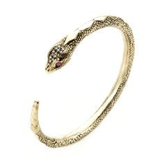 A solid 10K yellow gold serpent bangle with 14 white diamonds and ruby eyes. Interior dimension: 64 mm x 64 mm Width: 6 mm