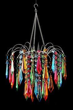 This fabulous design combines modern, affordable and chic to create this great looking Faceted Waterfall Chandelier. Decorate your next birthday party magnificently with this Multi-color Chandelier! The festive chandelier is made with acrylic cryst Chandeliers, Beaded Chandelier, Chandelier Lamp, Chandelier Ideas, Rustic Chandelier, Boho Home, Bohemian House, Bohemian Decor, Boho Chic