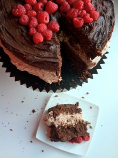 Chocolate cake with chocolate mousse filling, chocolate ganache and raspberries