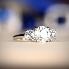 Three Stone Vintage Engagement Ring, featuring old European cut diamonds in a platinum mounting.