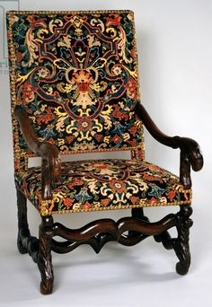 Late Louis XIII style armchair with petit point tapestry upholstery, with bowed legs and stretcher, France, 17th century; Private Collection; De Agostini Picture Library