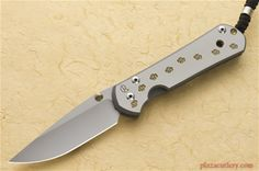 Chris Reeve Large Sebenza 21 with Dog Paw with Gold Anodizing and a Ti Dog Paw…