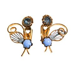 Blue Flower Earrings  Like a little bouquet Blue Rhinestone at top accented with chalcedony blue milk glass bead Gold Tone Setting with Painted