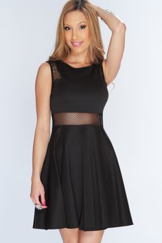 Like you, this dress was made for the spotlight!! As the sun goes down and and the city lights start to shine, your ready to throw this dress on with a sexy pair of pumps bold jewelry and a messy high bun and your ready to shine brighter then the night stars. Featuring netted detailing, sleeveless, scoop neckline, and finished with a flowy fit. 95% polyester 5% spandex. Made in USA