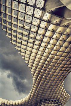 The Metropol Parasol by architectural studio Jürgen Mayer H. Covers the Plaza de la Encarnación and Roman ruins in Seville, Spain. 2011.