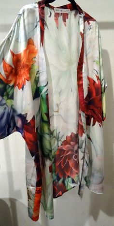 Gorgeous summer Dahlias explode across the silk in this PRINT of Tina Gleaves painting, Fireworks. Wear this piece and make a statement at a formal event. Wear it as a cover up or in an intimate setting. This is very versatile and silky soft.  Colors - white, red, purple, orange, green  Material - Option 1 - Sheer Georgette Option 2 - Shiny Satin  Care- Hand wash, mild soap, mild iron. Dry Clean ok.  Gift wrap available!  Fireworks PRINT available - Scarf, Shawl, Kimono, Shirt