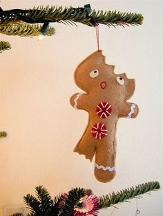 handmade-felt-ornaments...LOL! A gingerbread cookie with a bite out of his head and leg.