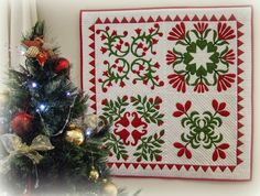 Four block applique quilt by Hilda at Every Stitch: Merry Christmas!