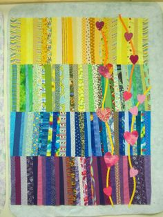 scrap quilt with appliquéd hearts quilt top by michele on the nostalgic cafe blog
