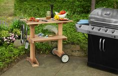 Use cedar boards and lawn-mower wheels to make a portable food cart