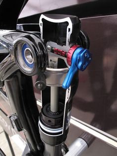This photo of a Fox Float DRCV shock cutaway clearly shows the larger air chamber below (with the damping rod running vertically in the middle of it) and the smaller secondary air chamber located above. Hidden behind the Trek bike's EVO link is the plunger that opens and closes the airway between the two. In the early stages of the travel the shock is working solely with the main air spring, at the 50% point of the stroke the plunger comes in contact with the seal head and is pushed up…