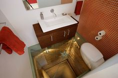 Bathroom with glass floor, overlooking a 15 story elevator shaft.    From The Archivist  http://thearchtivist.com/post/21757370594/bathroom-with-glass-floor-overlooking-a-15-story