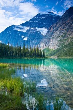 Mount Edith Cavell reflected in Cavell Lake - Jasper National Park, Alberta, Canada. Photo by Jerry Mercier.