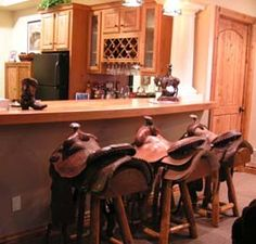 I think these bar stools are just so cool. Probably really expensive, but come on--conversation piece, comfy, AND write your own joke here? That's some multipurpose furniture right there.