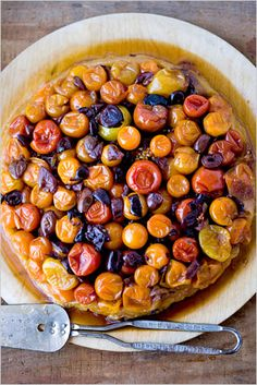 This tart is a stunning mosaic of red, orange and yellow tomatoes so shiny and candied that the tart really looks like dessert. But it's safely on the savory side thanks to a splash of vinegar and a sprinkling of briny olives. (Photo: Andrew Scrivani for The New York Times)