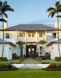 Style Indies Tropical Exterior Design Pale blue shutters metal roof Notice railing
