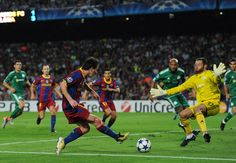 Lionel Messi (L) of Barcelona fires the ball at goalkeeper Alexandros Tzorvas of Panathinaikos during the UEFA Champions League group D match between Barcelona and Panathinaikos on September 14, 2010 in Barcelona, Spain. Barcelona won the match 5-1.