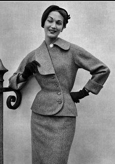1952 Teresita Montez in blue-beige wool suit with asymmetrical collar by Jean Patou