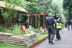 This is Brewer's Yard by Bestall & Co Landscape Design, with Welcome to Yorkshire at the 2015 RHS Chelsea Flower Show.  Lee Bestall is demonstrating that a garden wall can be a very comfortable seat.