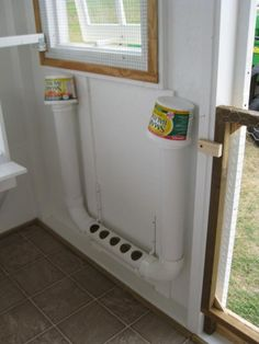 Chicken feeder - love the floor idea for the inside of this coop too - so much easier to clean out!