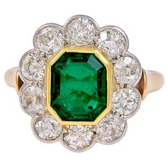 Emerald and Diamond Platinum and Gold Ring | From a unique collection of vintage fashion rings at http://www.1stdibs.com/jewelry/rings/fashion-rings/