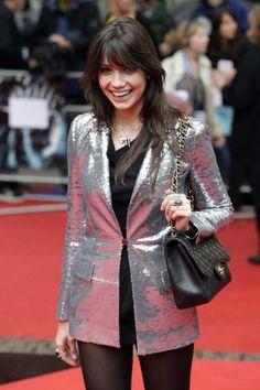Daisy Lowe in a silver jacket.